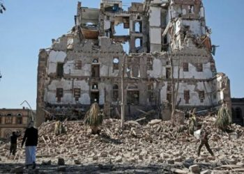 Shiite rebels walk amid the rubble of the Republican Palace that was destroyed by Saudi-led airstrikes, in Sanaa, Yemen, Wednesday, Dec. 6, 2017. Former President Ali Abdullah Saleh was killed on Monday by his onetime allies, the Iran-backed Houthis. Sanaa has witnessed heavy fighting since last week between Saleh's loyalists and Houthis forcing many Yemenis to cower indoors fearing the violent street clashes. (AP Photo/Hani Mohammed)