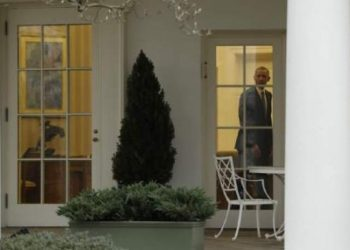 President Barack Obama is seen the Oval Office of the White House in Washington, Friday, Jan. 20 / AP