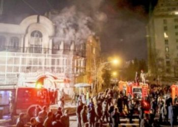 In this Jan. 3, 2016, file photo, smoke rises as Iranian protesters set fire to the Saudi Embassy in Tehran. — AP