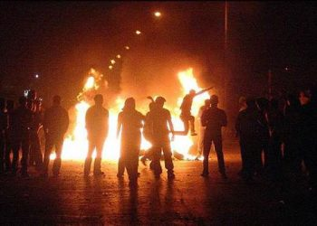Iranian youth celebrating Fire Festival in Tehran streets despite state warnings